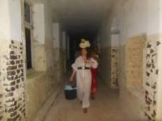 performing inside an old deserted hospital